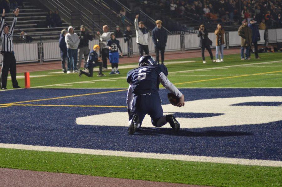 Sophomore Jack Lane picks himself up after scoring a touchdown