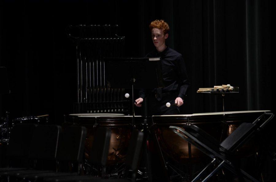 Junior percussionist Nate Waterbury plays the timpani.