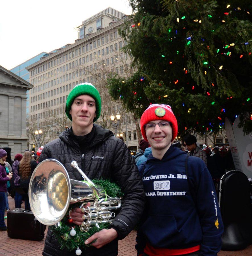 Seniors Bode Trappett and Daniel Michtom show off their custom Tuba Christmas hats.