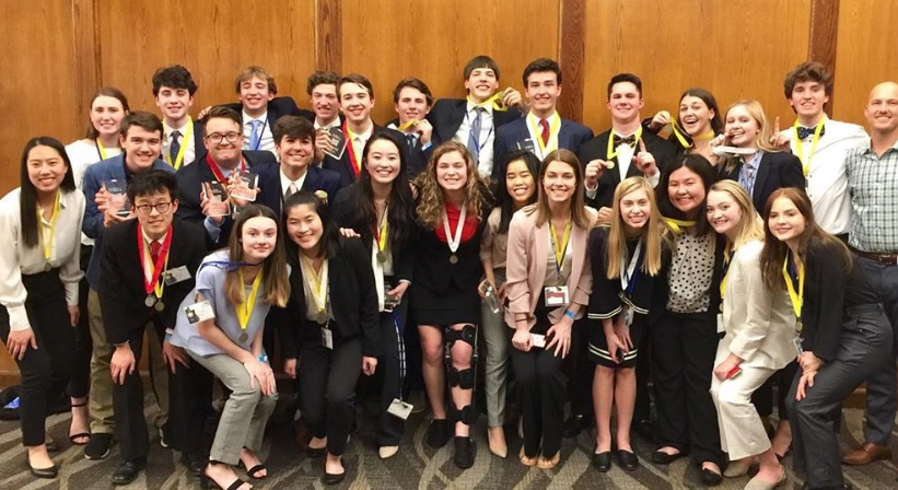 Lake Oswego DECA students pose with their awards after a successful tournament.