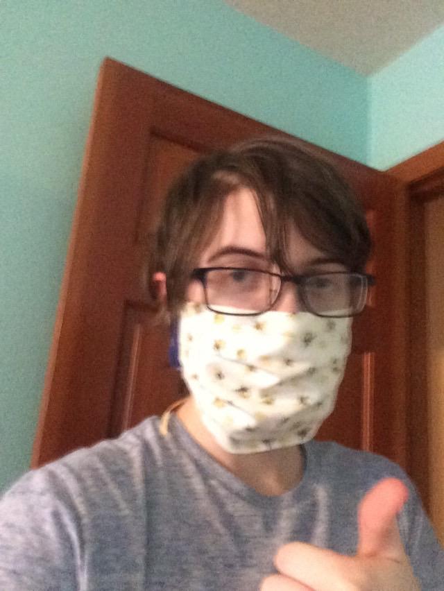 Senior Elliot Lloyd shows off one of their homemade masks.