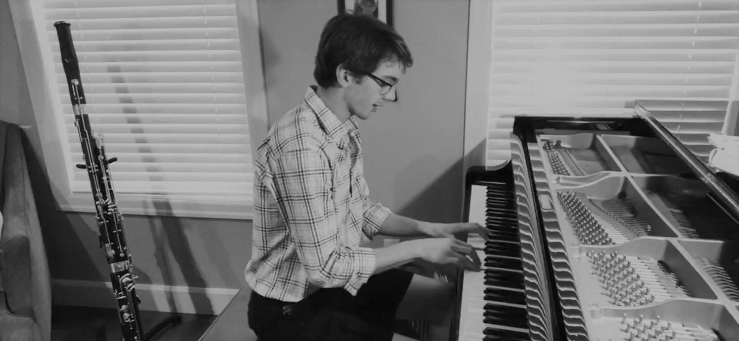 """Lance Pancoast performs """"Blackbird"""" by the Beatles from his home."""